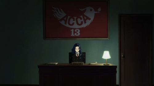 ACCA: 13-ku Kansatsu-ka / Episode 2 / Mauve sitting at her desk with only a dim light illuminating the room